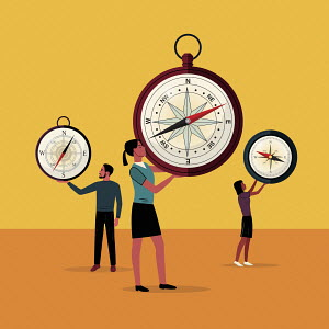 Young business people with compasses