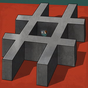 Young woman trapped inside hashtag symbol