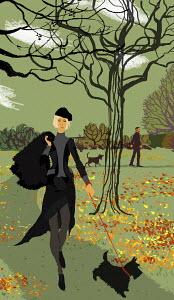 Stylish woman walking scottie dog in park