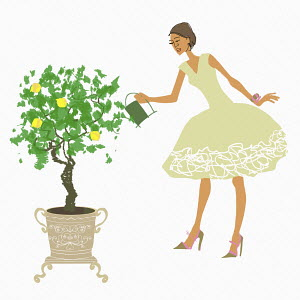 Woman watering lemon tree in pot
