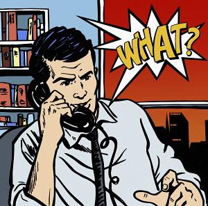 Businessman surprised at news on telephone