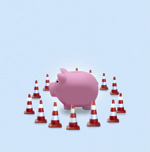 Piggy bank surrounded by traffic cones