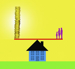 Family on house seesaw opposite pile of money