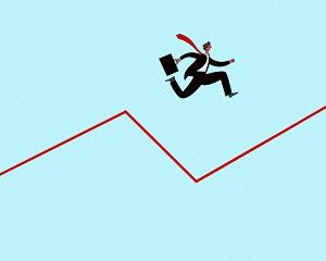 Businessman jumping across dip in graph