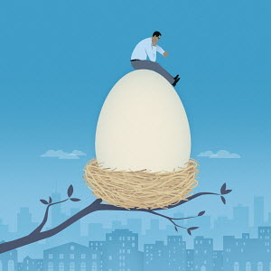 Businessman checking the time sitting on top of large nest egg