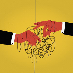 Businessmen's hands in tangled string