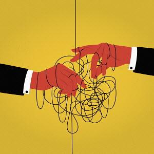 Businessmen's hands in tangled string