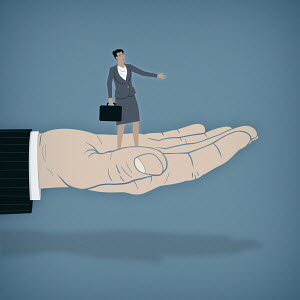 Businesswoman standing on helping hand