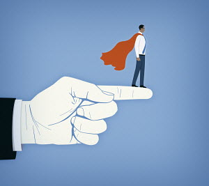 Businessman as superhero supported on large finger