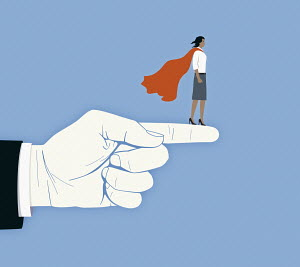Businesswoman as superhero supported on large finger