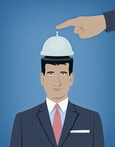 Someone ringing service bell on top of man's head
