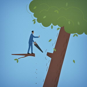 Businessman standing on branch while felling tree