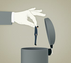 Large hand throwing unshaven businessman into bin