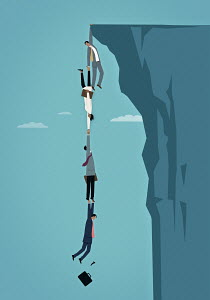 Business people dangling over edge of cliff holding on to each other in human chain