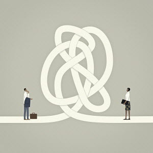 Businessman and businesswoman separated by tangled knot