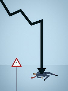 Businessman impaled by decreasing line graph arrow despite warning sign