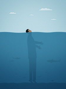 Businessman on tiptoes on seabed with face above water