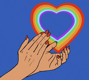 Close up of clapping hands and rainbow heart
