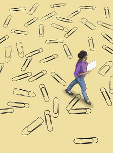 Woman walking over lots of paperclips