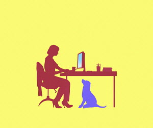 Dog watching woman working from home