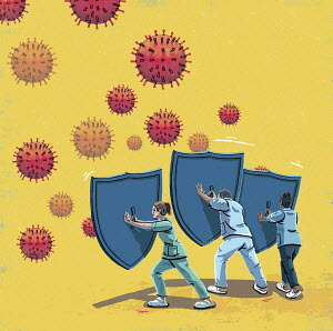 Healthcare workers with shields against coronavirus