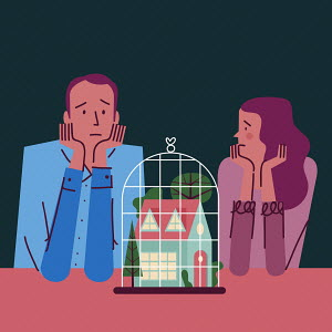 Sad couple looking at house in cage