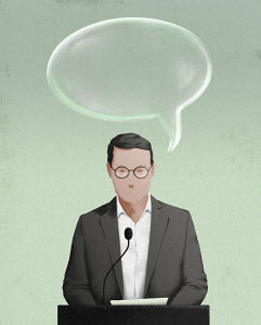 Man speaking at podium with soap bubble speech bubble