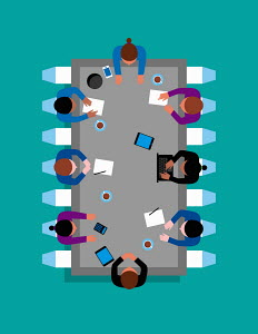 Business people sitting around microchip meeting table