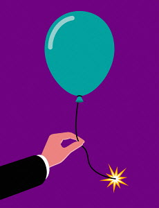 Businessman's hand holding balloon with lit fuse