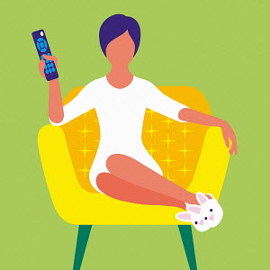 Woman sitting in slippers watching television