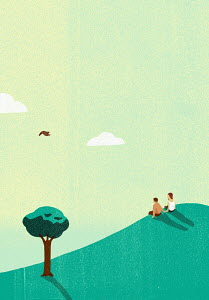 Couple sitting on hill watching bird in sky