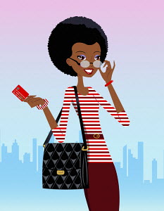 Happy woman holding credit card in city