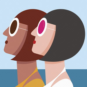 Two matching women looking up in sunglasses