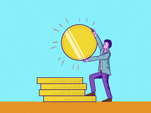 Man adding large gold coin to pile