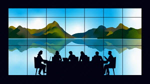 Business meeting silhouetted in front of beautiful landscape through window