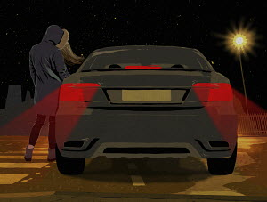 Prostitute standing beside car at night