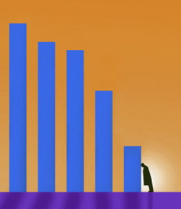 Businessman slumped in despair against falling bar chart