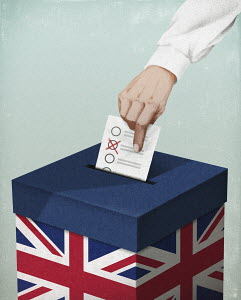 Hand putting voting paper in UK ballot box