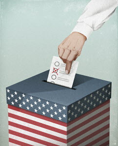 Hand putting voting paper in United States ballot box
