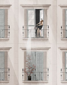 Woman watering plant on balcony below
