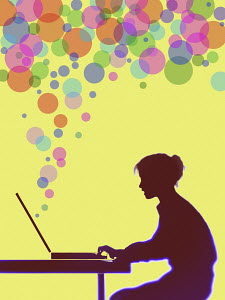 Colourful bubbles streaming from woman's computer