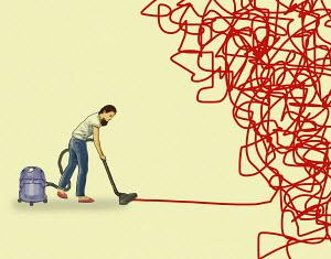 Woman vacuuming up tangled mess