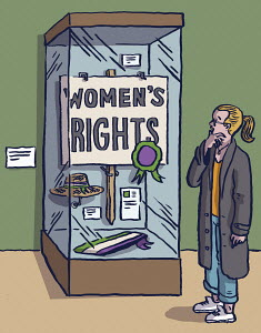Girl looking at Women's Rights display in museum cabinet