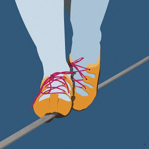 Close up of feet in shoes walking tightrope
