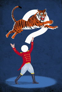 Circus performer with tiger jumping through question mark