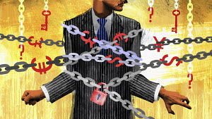 Businessman tied up in financial chains