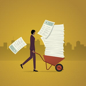 Businesswoman with wheelbarrow full of job applications