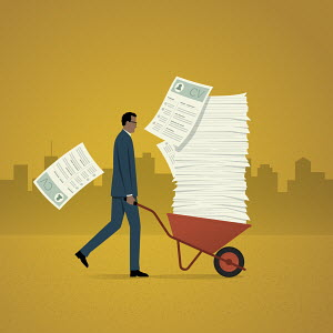 Businessman with wheelbarrow full of job applications