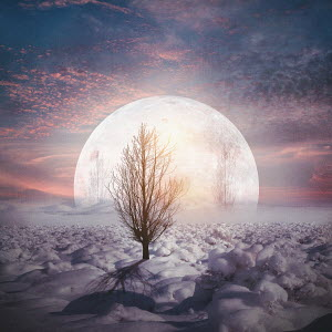 Huge moon in snowy landscape