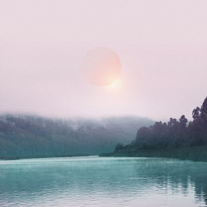 Pink sun in mist above lake